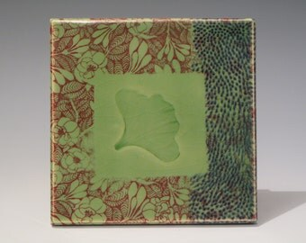 "Leaf Imprint Tile, 6"" x 6"", Grass green glaze with imprinted hosta leaf, underglaze decal design."