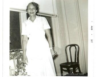 Woman in White Uniform with Houseplants, 1957, Snapshot Vintage Photo Old Photo Antique Black & White Photography Paper Ephemera