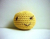 Smiley winky stress ball / baby rattle made from organic cotton