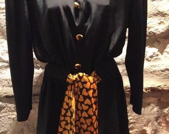 1980' shirtblouse, with huge shoulder pads. Size S/M.