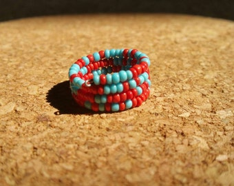 Beaded baby blue and red adjustable ring