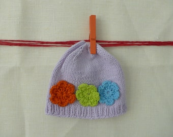 Cute girlish baby hat adorned with crochet flowers handmade natural fibers cotton