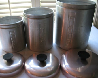 Boxes aluminum flour, tea, grease, 1950's kitchen Italy.deco.