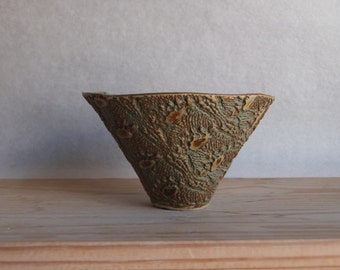 Stoneware lace imprinted conical bowl