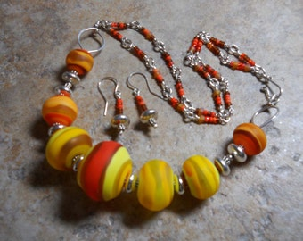 Hollow orange & yellow glass bead necklace set with Sterling silver spacers