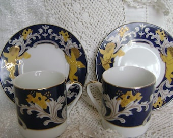 Pair Of Cherub/ Putti Design Demitasse/ Espresso Cups And Saucers] In  Cobalt Blue