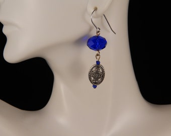 Handmade earrings with blue crystal beads, metal charm, and surgical steel  earwire