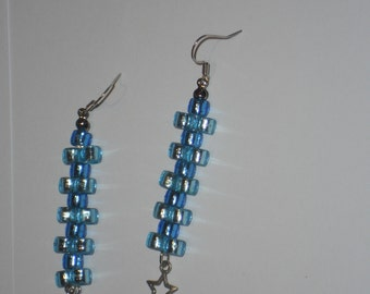 Blue unusual long drop dangle earrings with offset beaded strands with star charm.