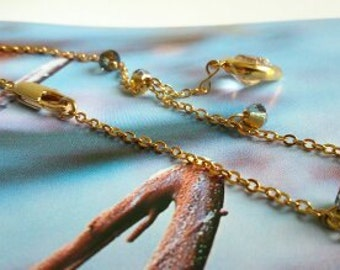 """Bracelet swarovski crystal """"anthracite / gold ' and 'volcano' heart and gold plated chains."""