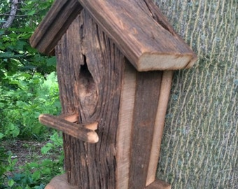 Handmade rustic bird house.
