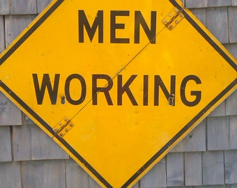 Large men working retired highway sign; vintage road sign; man cave; boys room; garage decor