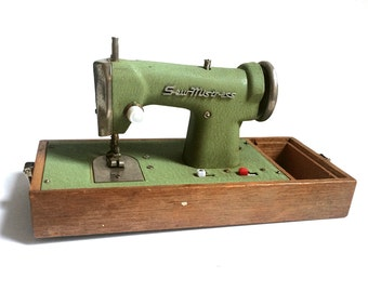 Vintage Sew Mistress Toy Sewing Machine