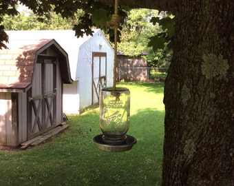 Hanging bird feeder from antique Mason jar