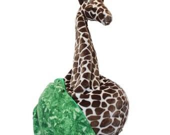 Giraffe bean bag chair with blanket of grass