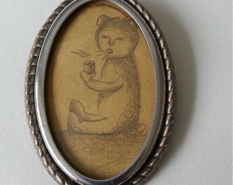 Drawing within a vintage brooch