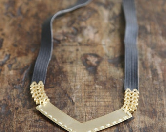 Imitation leather necklace and gold element