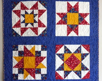 Summer Stars Table Topper, small quilt or wall hanging, patriotic quilt in red, white, blue and yellow with flag binding