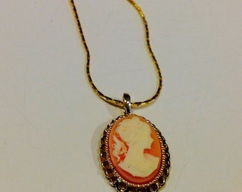 Vintage raised cameo woman with ponytail profile oval with gold tone pendant necklace