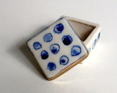 tiny porcelain box with blue underglaze dot pattern and 22k bright gold luster