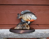 Hand-carved, hand-painted Blue Gill statue