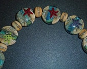 Set of 7 Starfish Lampwork Beads with 8 Pebble Spacers