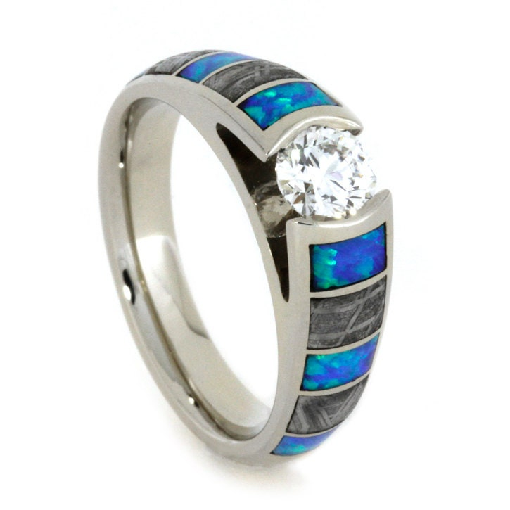white gold engagement ring with opal and by jewelrybyjohan