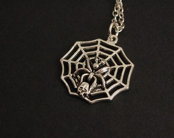 Silver tone spider web necklace
