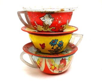 50s Tin Toy Tea Cups & Saucers, Set of 6 with puppy, lamb and pelican.