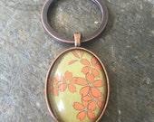 Julie's Flowers - oval glass key chain