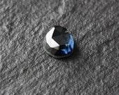 blue faceted sapphire cabochon