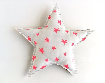 Star shaped pillow with neon pink stars print