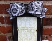Black olaque frame with black and white damask ribbon and black rhinestone embellishment