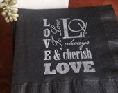 Pack of 50 black luncheon sized 3 ply napkins with white LOVE and CHERISH wording in white.
