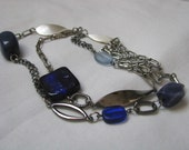 Silver tone chain necklace with beautiful blue beads