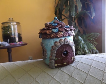 Fairy Cottage made from Polymer Clay and Recycled Jar