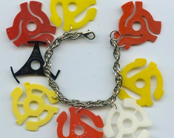Retro charm bracelet 1950's vintage 45 record adaptors theme from recycled items