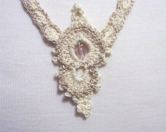 Crochet Necklace off white color with light pink glass bead 23 inch long
