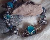 Elegant Teal, silver and goldtone bracelet