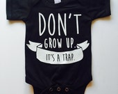 Don't Grow Up. It's a Trap. Tshirt - Available in various colors and Sizes
