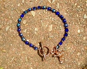 Bracelet With Copper Frog Charm and Colbalt Blue Glass Czech Beads