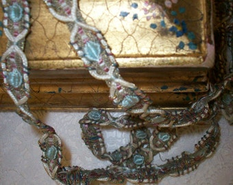 metal trim with a ribbon work look  RARE