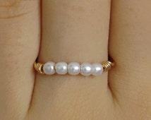 gold ring, pearl ring, tiny pearl ring, thin pearl ring, band ring, thin gold ring, stacking ring, dainty ring, row pearl