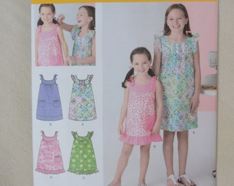 Girl's Dress, Summer Sundress, Ruffle or Bow Sleeves, Ruffle Hem- UNCUT Simplicity Learn to Sew Sewing Pattern 2241, Sizes K5 7-14
