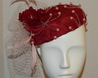 red and Pink Beaded hat with feathers and netting
