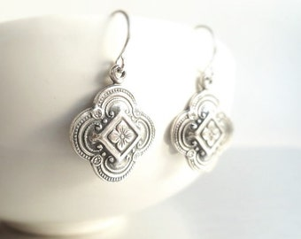 Silver Clover Earring - sweet little silver stamped 4 leaf / lobe charm in antiqued finish on small simple ear hook - boho ornate detail
