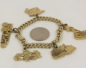 Gold Charm Bracelet with 5 Caterpiller Construction work type charms, Road grater, Engine, Front end loader,