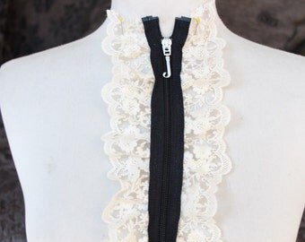Cute zipper    applique  with  ivory  color ruffled  1 pieces listing 19 inches long 4 1/2 inches wide