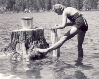 Woman WASHING Clothes On a STUMP In The LAKE Photo Circa 1950