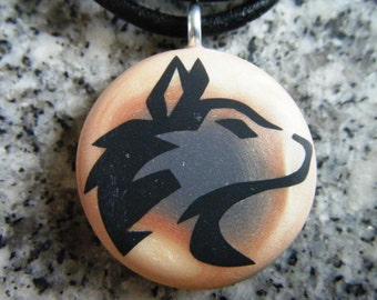Husky design hand carved on a polymer clay copper/grey pearl color background. Pendant comes with a FREE necklace