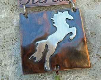 Copper and sterling silver horse pendant with book of secrets and peridot gemstone